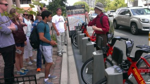 Paul DeMaio demonstrates how Capital Bikeshare kiosks work.