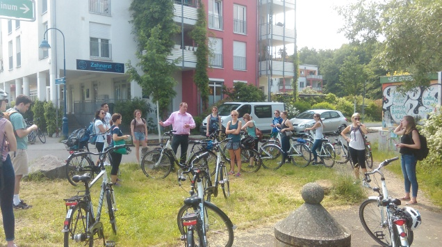 Bike tour through sustainable neighborhoods.